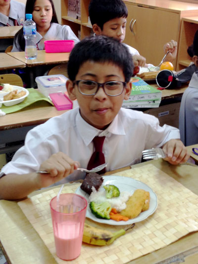 Nutrition Month A pupil enjoying the nutritious food prepared in his plate